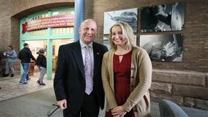 President Keith Taylor and Erin Hart stand before the newly unveiled statement piece in the Waldron Campus Center