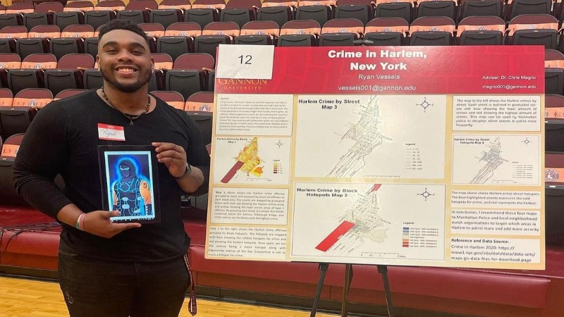 Gannon student Ryan Vessels, presenting on his mapping on Crime in Harlem, NY