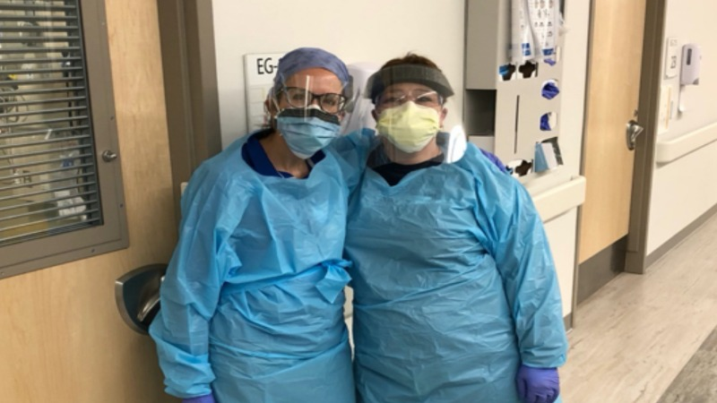 Nicolette Mosinki (Gannon alum & former faculty member) and coworker at St.Vincent/AHN wearing donated materials.