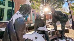 Statue of Jesus with Students on Gannon's Campus